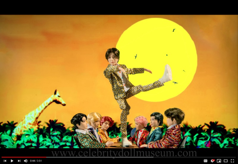 SUGA and BTS as dolls in an IDOL video still